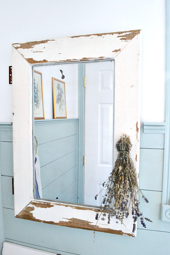 DIY Farmhouse Mirror Tutorial. Turn a salvaged window into a farmhouse mirror in just a few easy steps! Find it on theweatheredfox.com