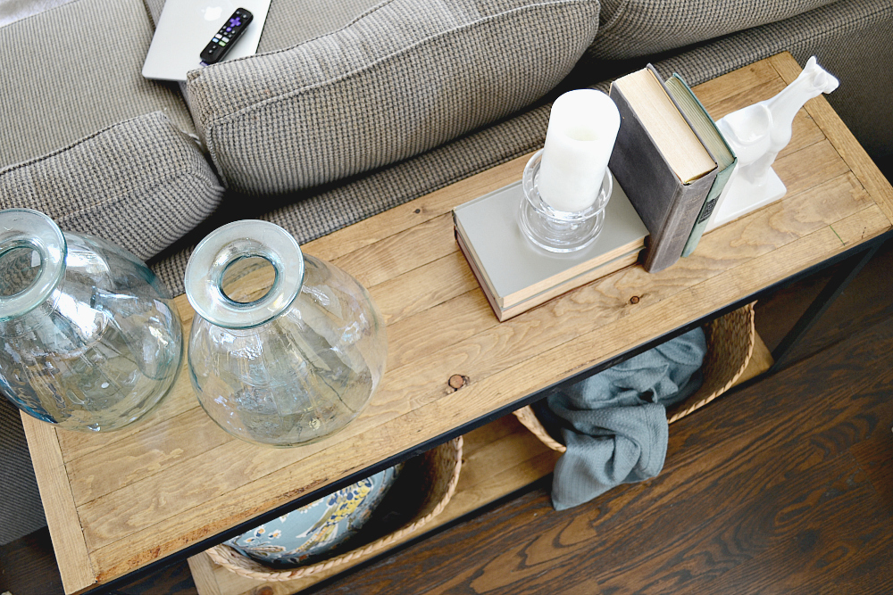 DIY Industrial Farmhouse sofa table. Turn a metal shelf into rustic shelving. Check out more at theweatheredfox.com