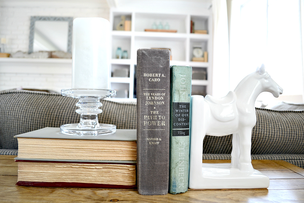 Where to buy farmhouse decor. DIY Industrial Farmhouse sofa table. Turn a metal shelf into rustic shelving. Find out more at theweatheredfox.com