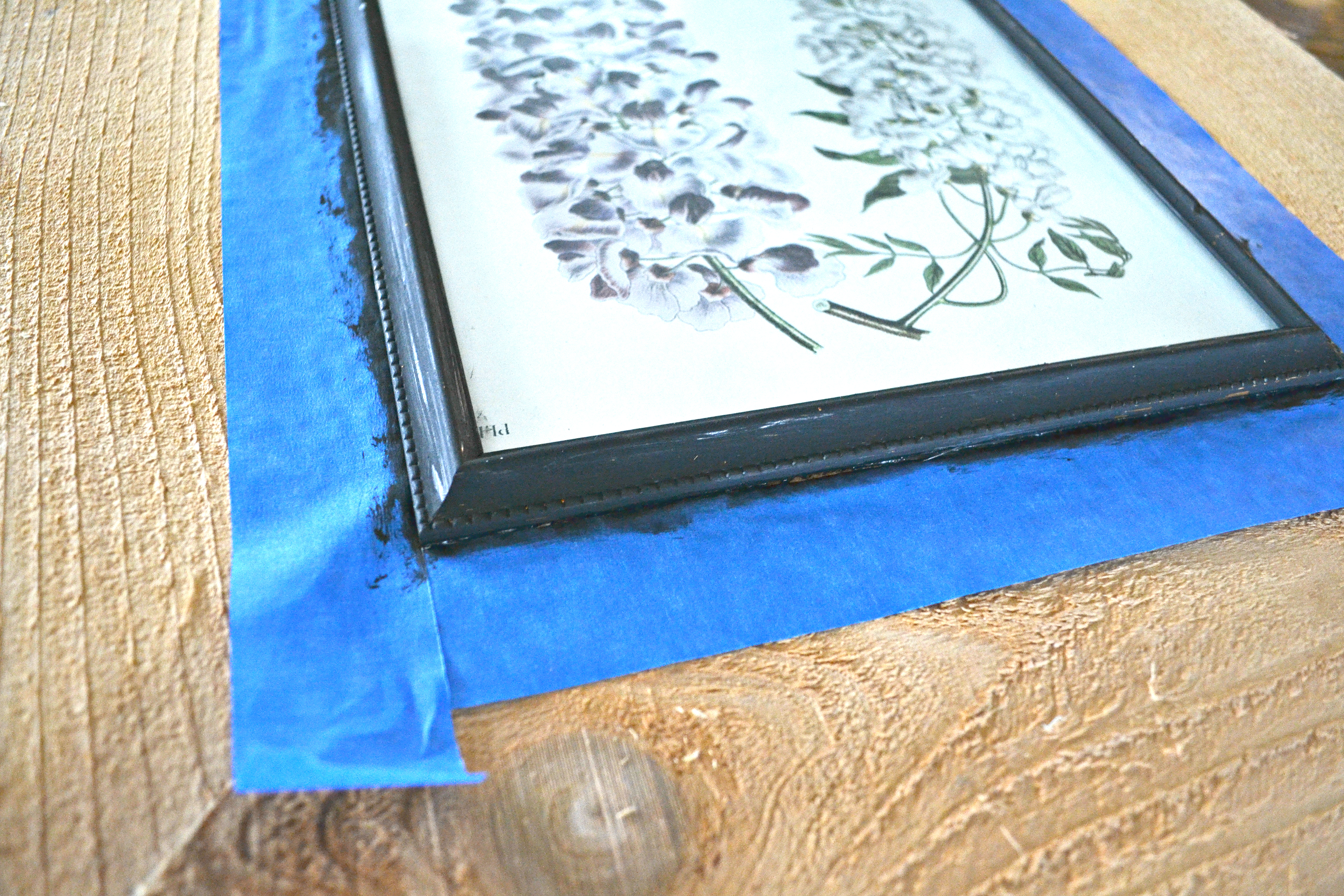 Make a giant wood frame from a dollar store picture frame