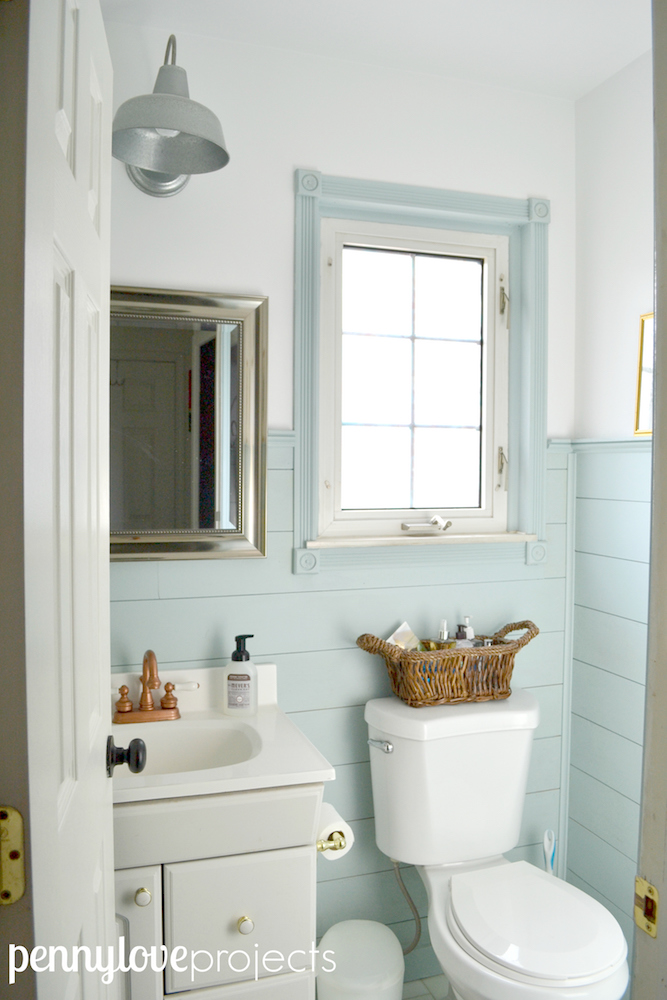 How to paint a laminate vanity to look like weathered wood in a few easy steps.