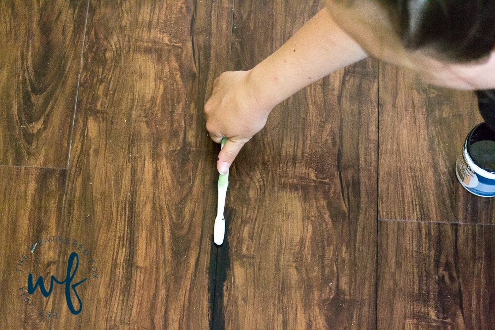 installing-vinyl-plank-flooring-in-laundry-room-6