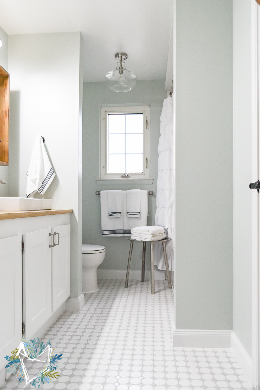 This Modern Farmhouse Bathroom is the perfect way to get a fixer upper farmhouse look on a budget! Your guests will think Joanna Gaines designed it herself. Come see this amazing transformation!