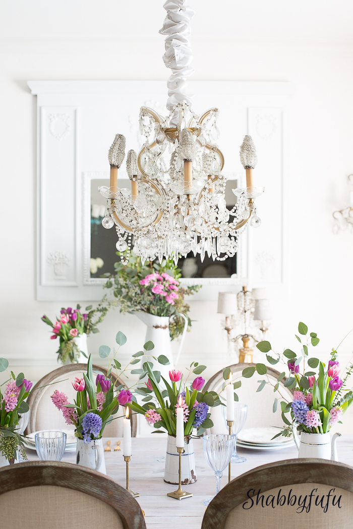Spring Farmhouse Tours. It's all about mixing and mingling the colors of whatever seasonal or silk florals you can find for your spring centerpiece and set against a white background.