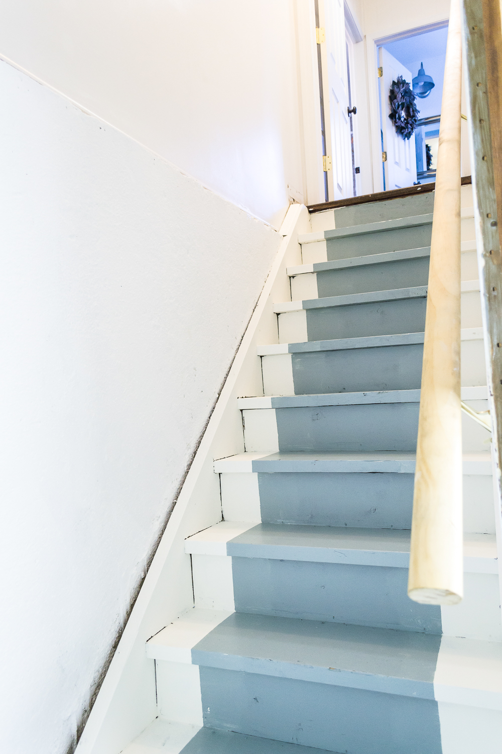 How to paint basement stairs and give wood stairs a fresh farmhouse style. Paint your stairs in a few easy steps!