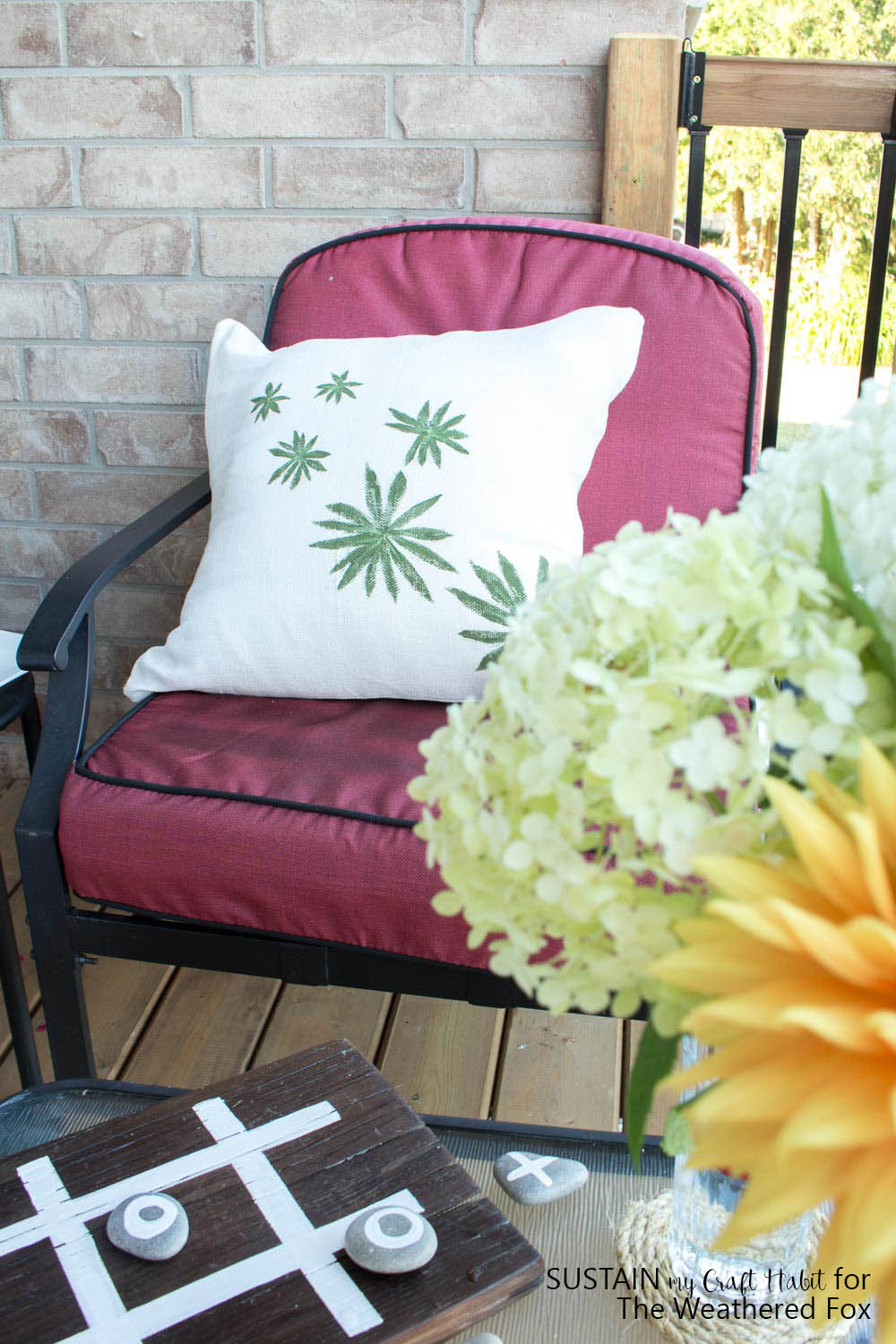 Upcycle a plain throw pillow into an inexpensive DIY outdoor pillow cover. Lovely patio or porch idea for the summer. Full tutorial included.