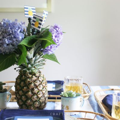 Simple Pineapple Centerpiece With Hydrangeas And Blueberries