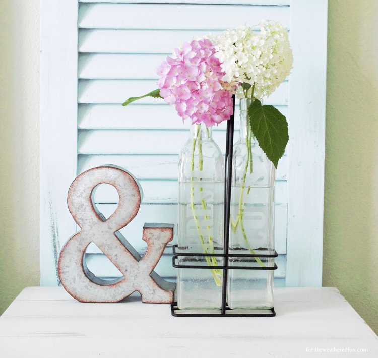 Creating a DIY farmhouse vase is easy using some upcylced bottles and etching cream. I love the clean, farmhouse style and these will blend perfectly! - www.theweatheredfox.com