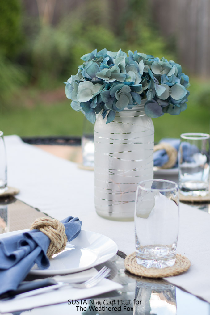 DIY wedding or summer table centerpiece. Upcycled pickle jar craft. Mason jar upcycling idea. Summer patio lantern.