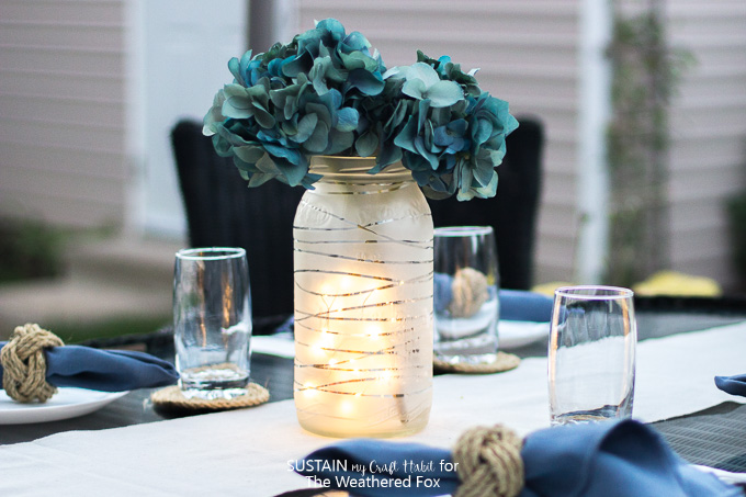 Gorgeous DIY faux floral centerpiece: an upcycled, frosted glass jar with silk hydrangeas.