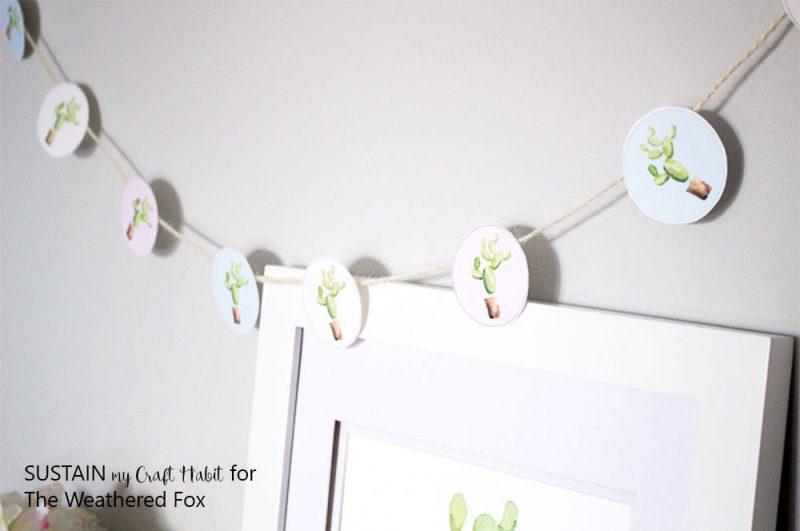 Simple watercolor cactus garland. Great baby shower decor idea!