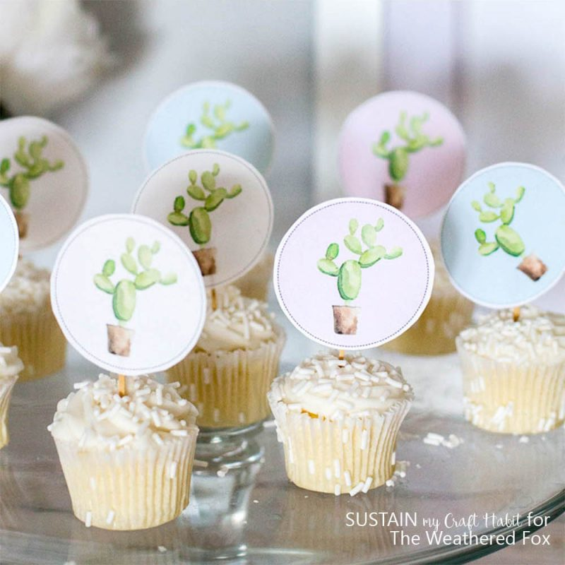 So adorable! Free printable watercolor cactus cupcake toppers and garland. Perfect for a baby shower, cinco de mayo party idea, fiesta party or birthday.