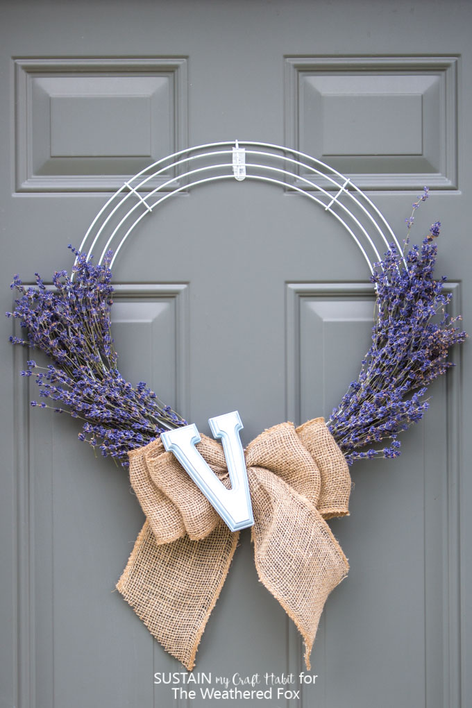 Learn how to make this simple and beautiful lavender wreath with a burlap bow and monogram letter! Full step-by-step tutorial is included.