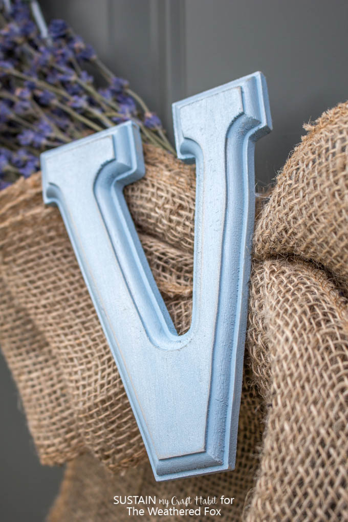 Shimmering blue monogram on a lavender and burlap wreath. Full tutorial for this farmhouse inspired lavender wreath.