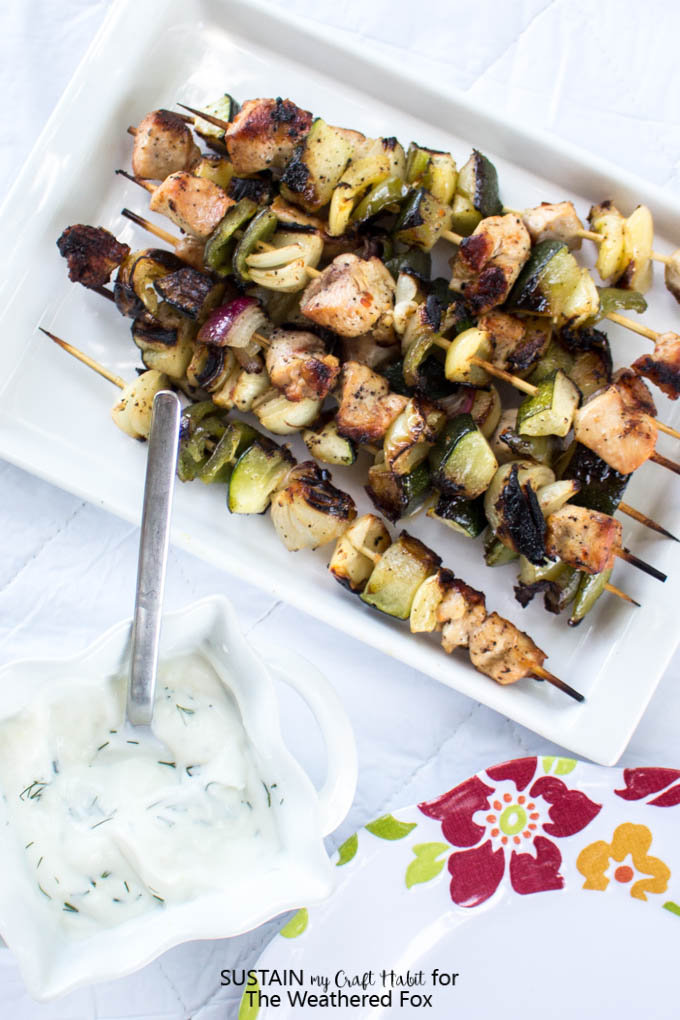 Simply seasoned grilled chicken shish kabob recipe with a creamy dill dip. Delicious low-fat, gluten free dinner or BBQ idea!
