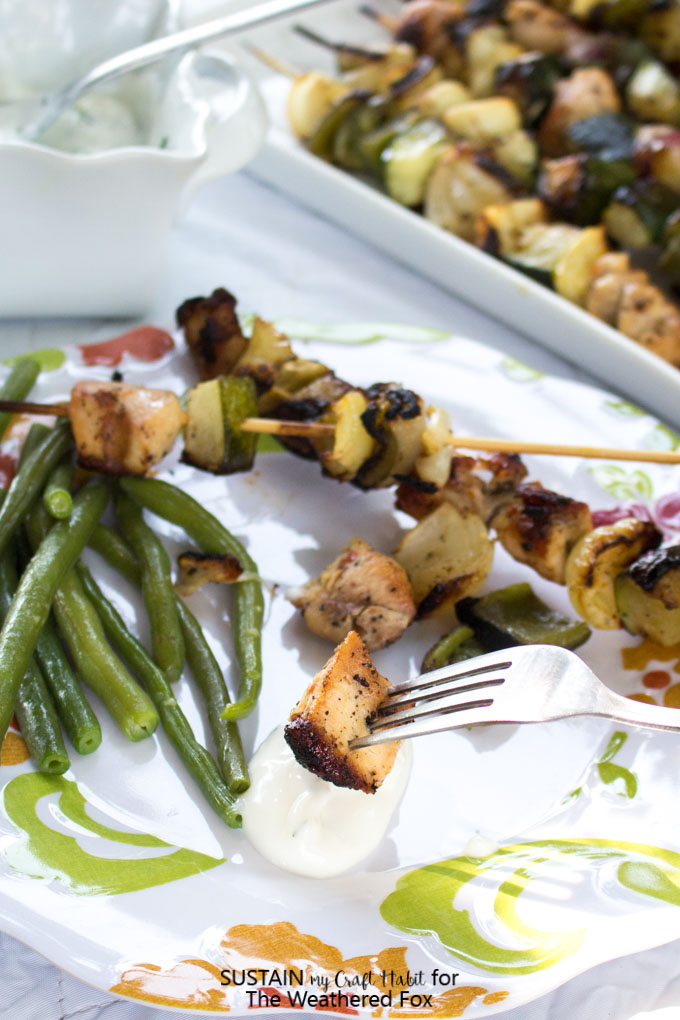 Perfect for BBQ season! Simply seasoned grilled chicken shish kabob with a creamy dill dipping sauce. A low-fat, gluten-free dinner recipe idea.