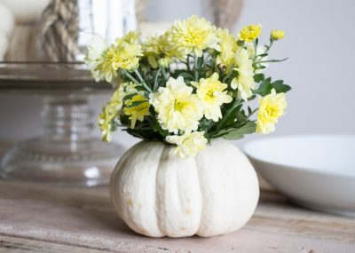 Simple fall decorating ideas including mini fresh pumpkin vase