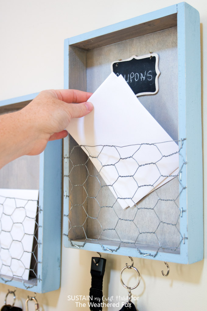 Get organized with a DIY farmhouse inspired entryway organizer. This home organization idea is a great place for your keys, coupons and to sort incoming mail! Full tutorial included.