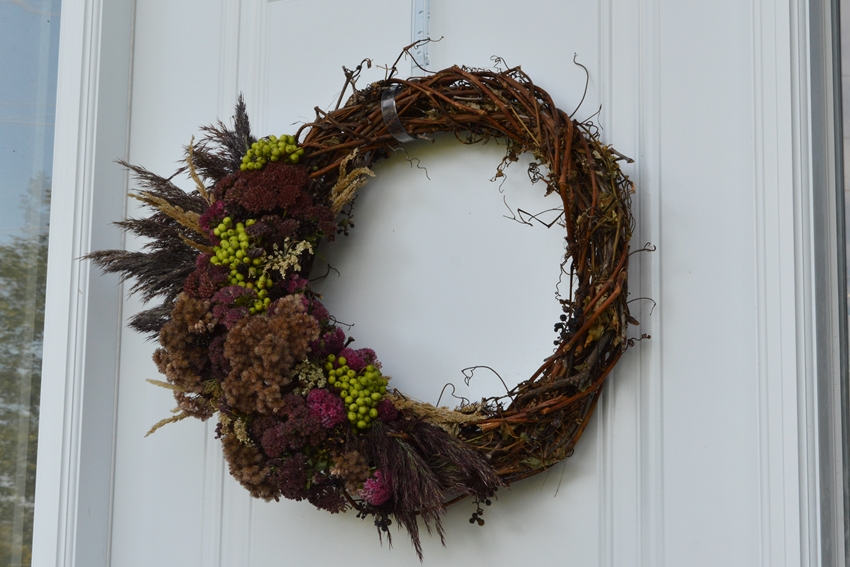 DIY grapevine wreath with pinks, purples and lime green