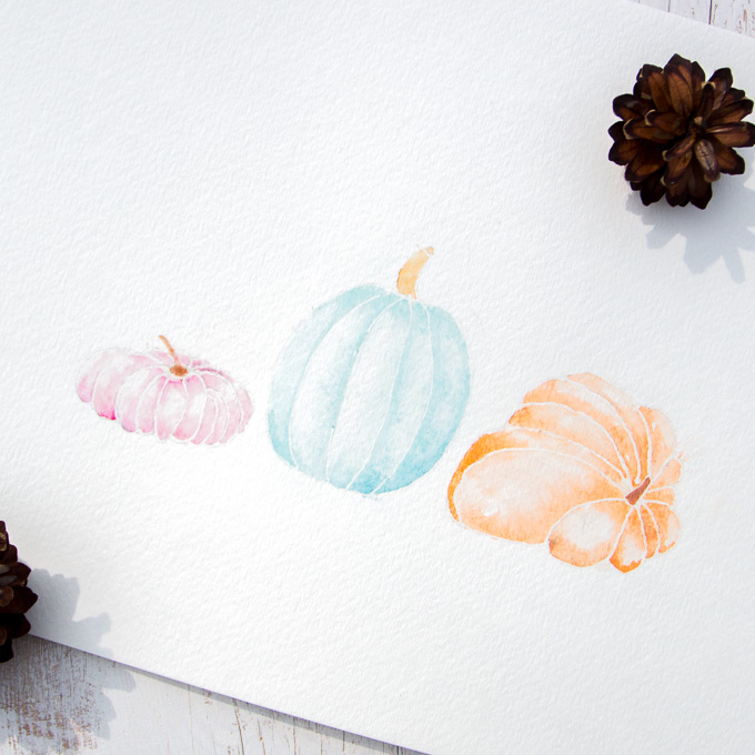 "This watercolor pumpkin painting is a beautiful reminder to appreciate nature's fall bounty. Free ""Thankful"" print for your autumn decorating."