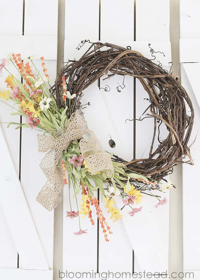 Brighten up your home with a DIY spring wreath for your front door! I've gathered some beautiful farmhouse style wreath ideas that are easy DIY spring crafts you'll be sure to love!