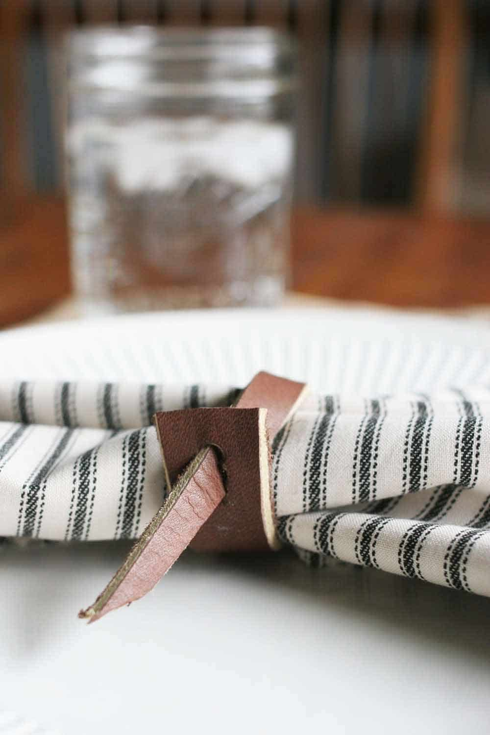 leather napkin ring, ticking cloth napkin